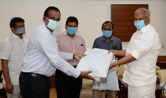 Immediate Past Chairman Shri. Suresh Kumar S. handed over PPE kits and Masks to Hon.Minister A.C. Moideen